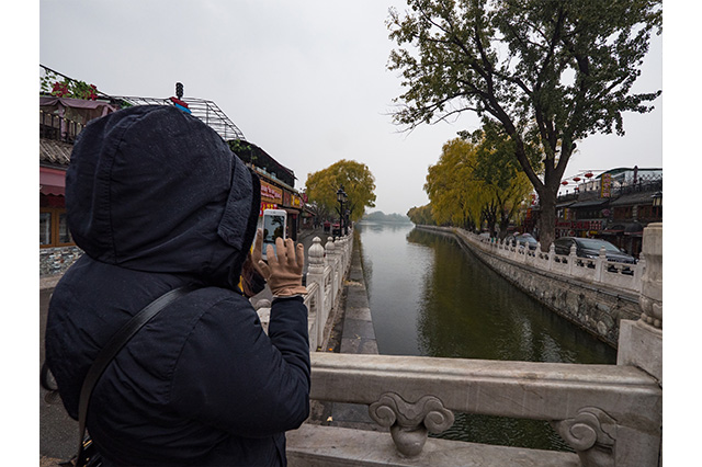 taking photos in Hou Hai Lake Beijing China