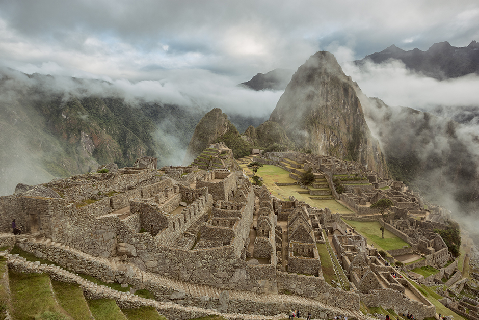 Machu Picchu in fog at sunrise