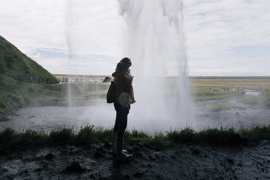walking behind a waterfall in Iceland